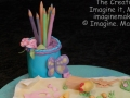 Artist Cake With Pencil Container and Paper Collage